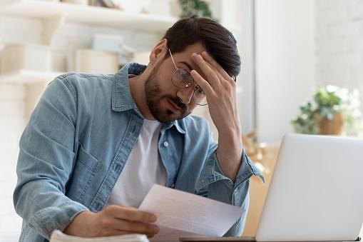 Stressed guy worried money problem