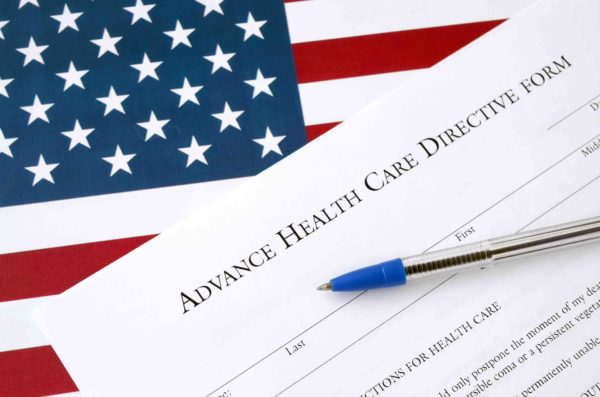 A pen lying on top of an Advance Health Care Directive Form