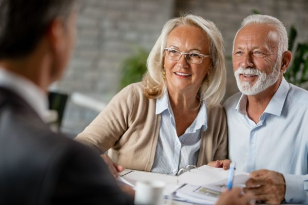 An older couple meeting with an estate planning attorney