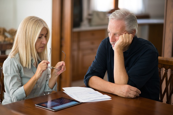 Senior couple calculating their living expenses together